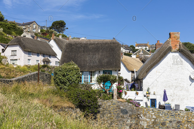 June 27, 2018: Thatched cottages in Cadgwith, Lizard Peninsula, Cornwall, England, Great Britain, British Isles, United Kingdom, UK