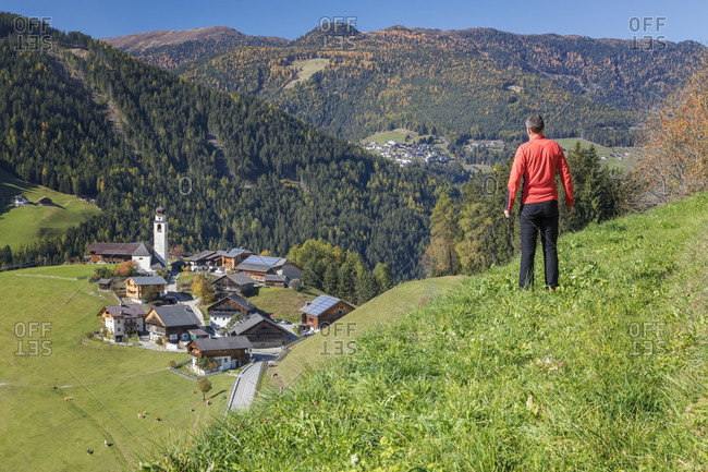 Man looking from above on the village of Corte - Curt in the valley of Marebbe - Enneberg, Bolzano, Alto Adige, Sudtirol, Italy
