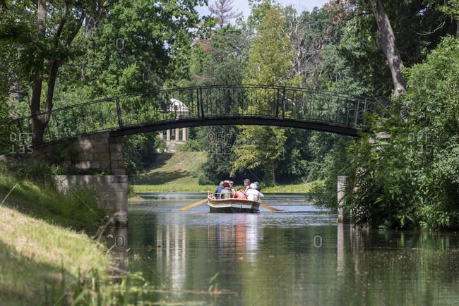 Germany, Saxony-Anhalt, Worlitz, tourists ride gondolas through the canals of the Worlitz Garden Realm, Unesco World Heritage.