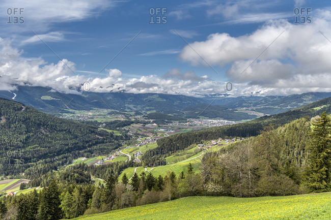 Percha, Bolzano province, South Tyrol, Italy. View of the village of Percha and the city of Bruneck in the background
