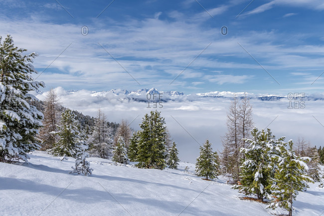 Percha, Bolzano province, South Tyrol, Italy. Snow in spring above the Gonner Alm. In the background the Dolomites