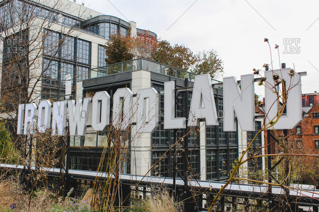 November 18, 2018: Sightseeing along the High Line in Manhattan with a view of graffiti and apartment buildings