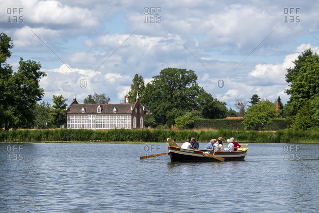 July 11, 2020: Germany, Saxony-Anhalt, Worlitz, gondola with tourists, palm house, Unesco World Heritage.