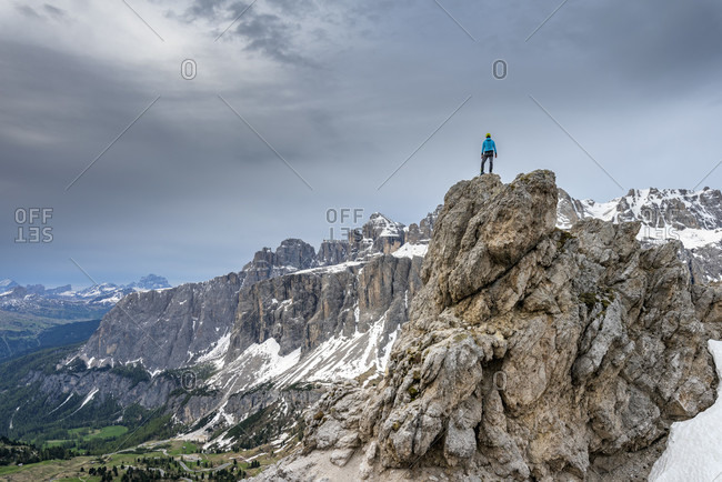 Gardena Pass, Bolzano Province, South Tyrol, Italy. Mountaineers at the summit of the Kleine Cirspitze