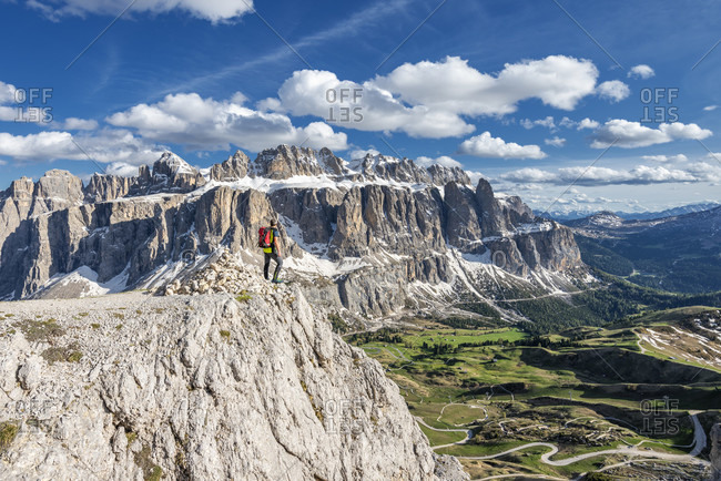 Gardena Pass, Bolzano Province, South Tyrol, Italy. Mountaineers on the way to the Grosser Cirspitze