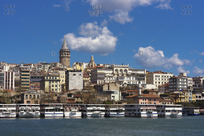 April 10, 2015: Turkey, Istanbul, At the Galata Bridge, view to the Galata Tower, ship landing stage