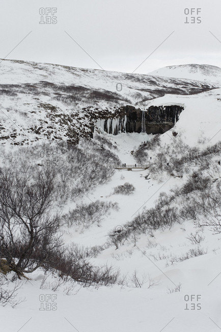 March 14, 2020: View of the Svartifoss in the snow-covered Skaftafell National Park, South Iceland