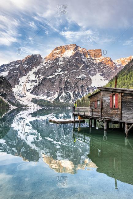 Braies, Dolomites, Bolzano Province, South Tyrol, Italy. Lake Braies with the Seekofel at sunrise