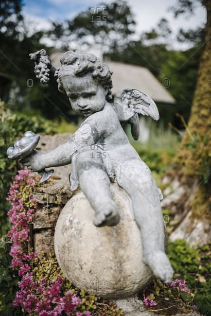 Stone sculpture of a cherub in the gardens of Glenveagh Castle, Glenveagh National Park, Ireland