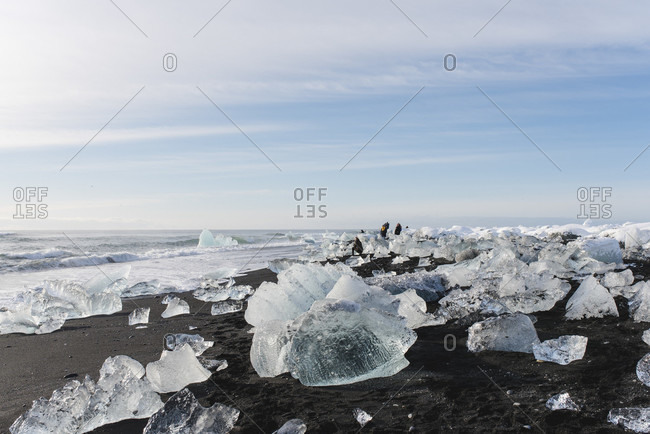 March 15, 2020: Tourists on Black Diamond Beach with its eponymous ice formations, Iceland
