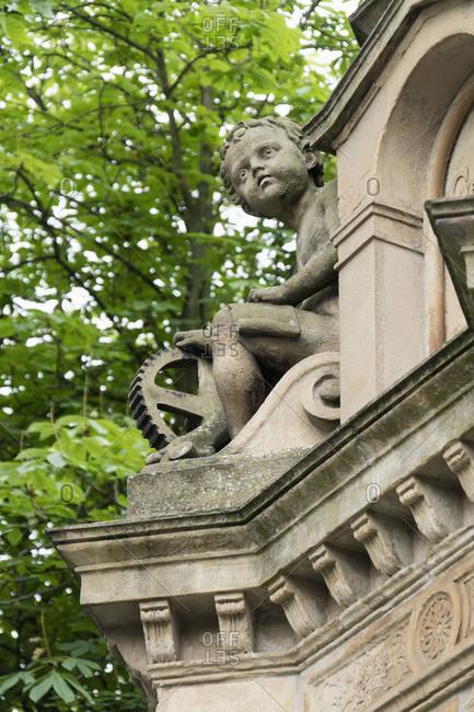 June 11, 2020: Duisburg, historic old town, Burgplatz, Mercator fountain, detail (child)