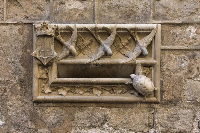 March 31, 2016: Barcelona, Casa del Arcediano, marble mailbox with swallows and turtles