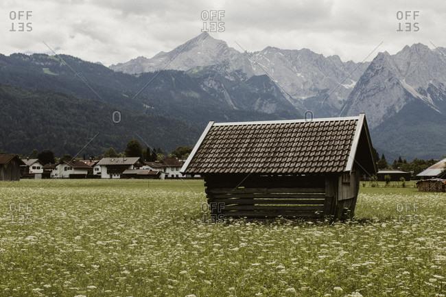 Wooden hut - hay barn in Garmisch-Partenkirchen with alpine panorama in the background