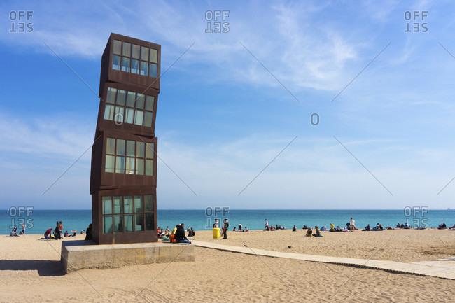 "March 31, 2016: Barcelona, Playa de Barceloneta, beach, sculpture ""Lestel ferit"""
