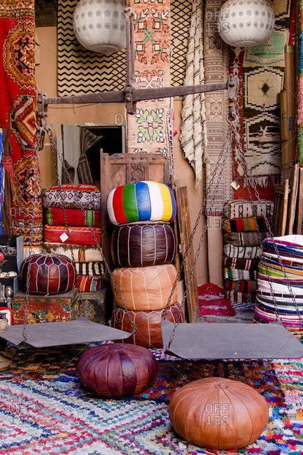 Souk of Marrakech in the medina with pottery, leather goods, poufs and lamps
