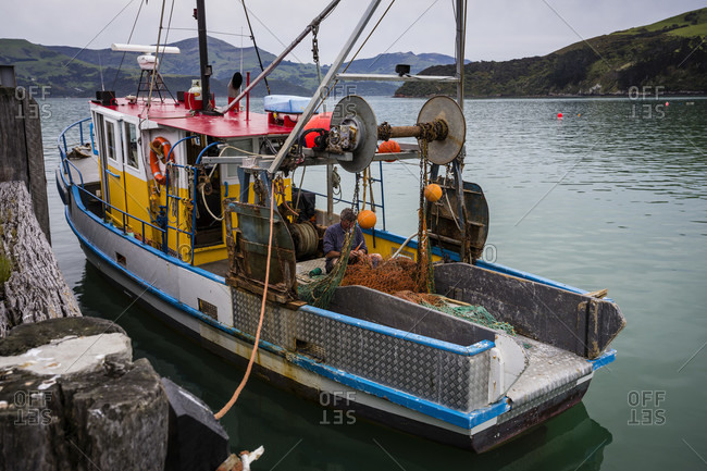 October 24, 2016: Fishing net patches on the fishing boat in Akaroa harbor