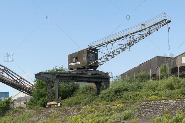June 11, 2020: Duisburg, outer harbor, crane, Hansa Holz Schweitzer GmbH