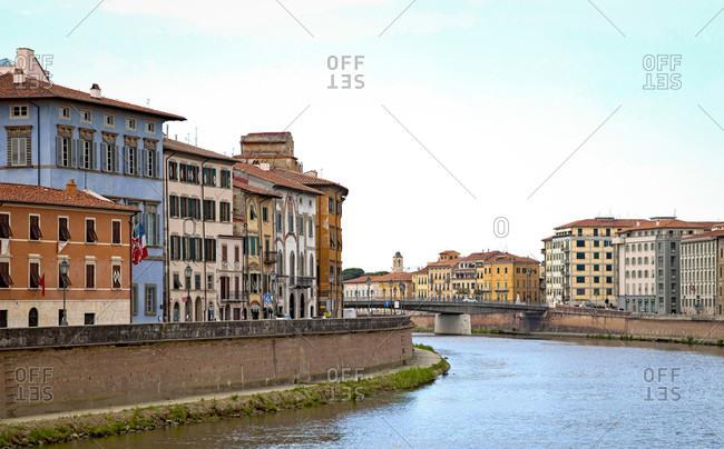 June 17, 2018: Panorama, Arno river, houses, Pisa, Tuscany, Italy
