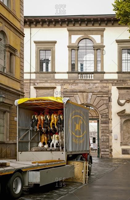 June 15, 2018: Carousel horses, trucks, Lucca, Tuscany, Italy