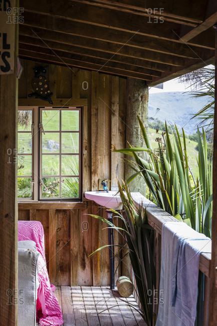 Wooden hut terrace with outdoor sink in Akaroa