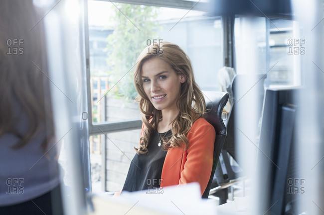Female entrepreneur sitting on chair in office