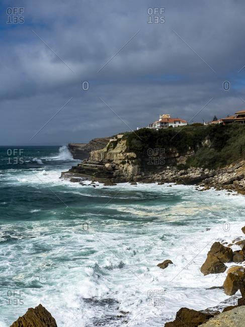 Portugal- Lisbon District- Azenhas do Mar- Waves splashing below cliffs of seaside town