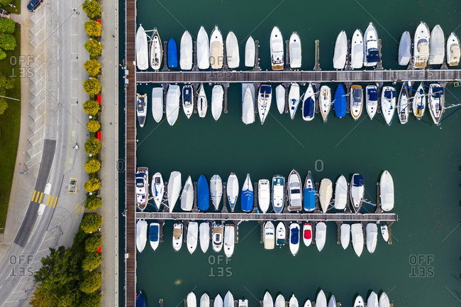 Switzerland- Canton of Ticino- Locarno- Helicopter view of boats moored in harbor of lakeshore town