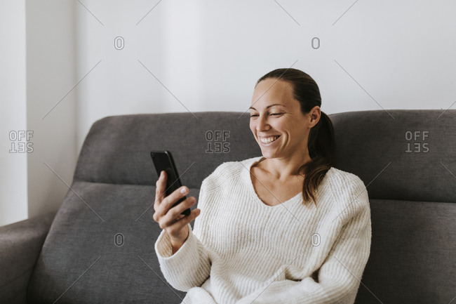 Smiling woman smiling during video call at home
