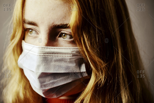 Close-up of teenage girl wearing protective face mask