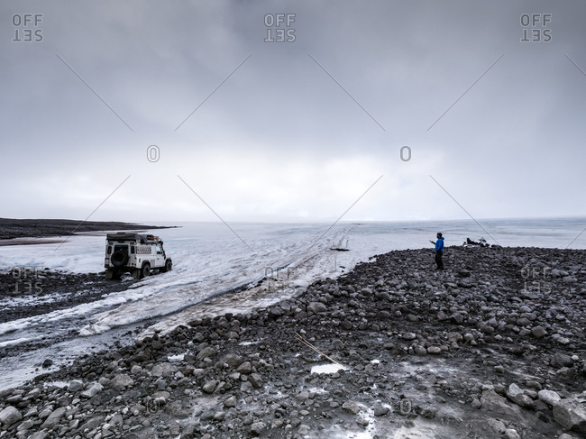 Man with off road vehicle by glacier during vacation- Langjokull- Iceland