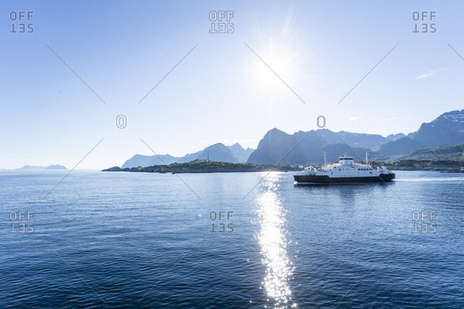 Ferry in sea against clear sky at Lofoten- Norway
