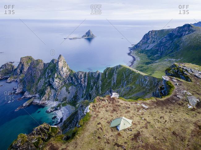 Man camping on mountain at Matind- Andoya- Norway