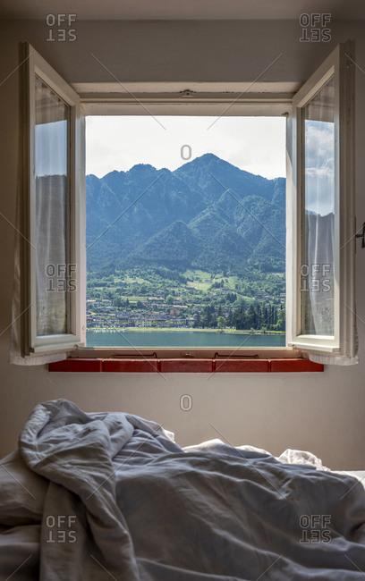 Mountain range seen through bedroom window