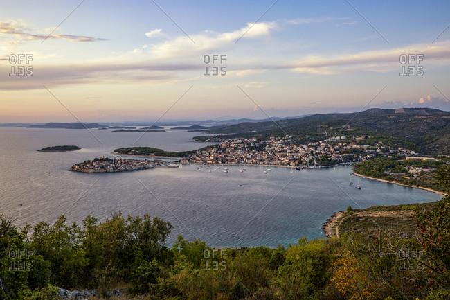 Croatia- Sibenik-Knin County- Primosten- Town on Adriatic coast at dusk