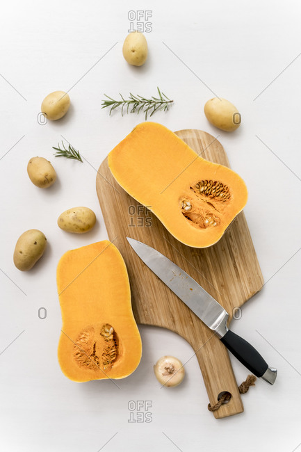 Studio shot of halved squash lying on cutting board