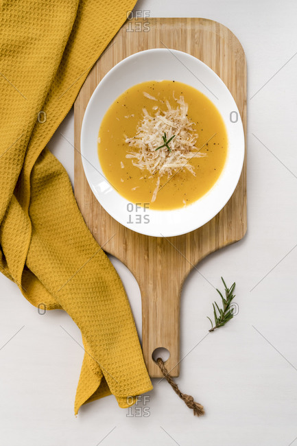 Napkin- cutting board and bowl of fresh homemade pumpkin soup with puree