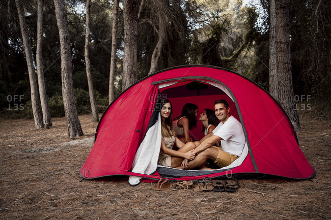Happy family in tent during vacation