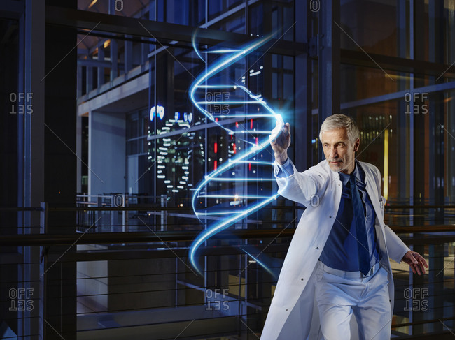 Male doctor analyzing DNA in laboratory at hospital