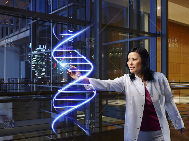 Mature female doctor light painting DNA in laboratory at hospital