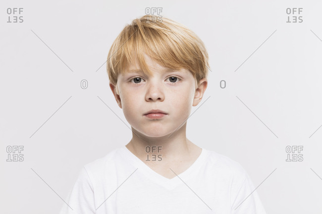 Cute boy in t-shirt against white background