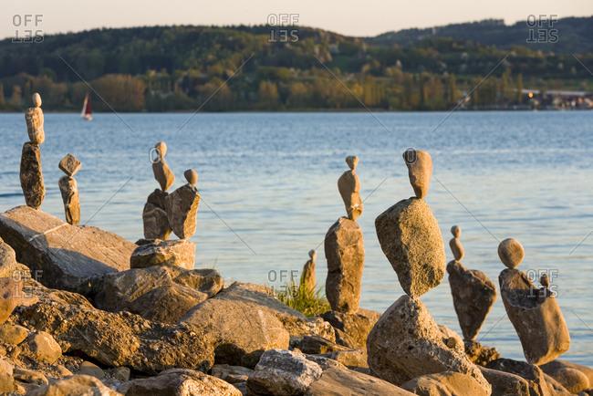 Rock stacks balancing on shore ofLake Constance
