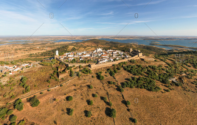 Aerial view of the Monsaraz Castle on a hill overlooking countryside, Portugal.