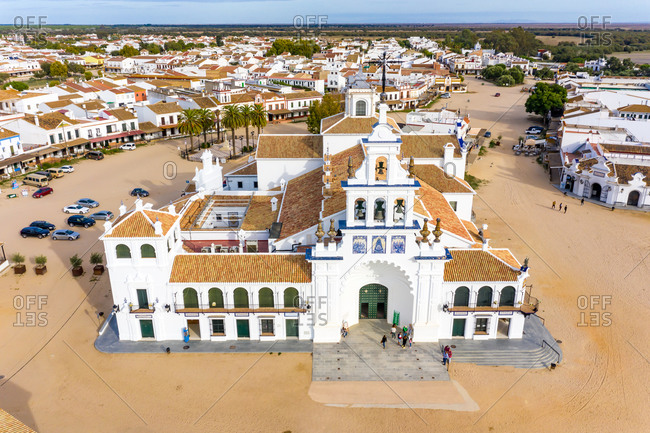 Aerial view of a sanctuary called Ermita del Rocio with the streets covered in dirt in the town of El Rocio, Huelva, Spain.