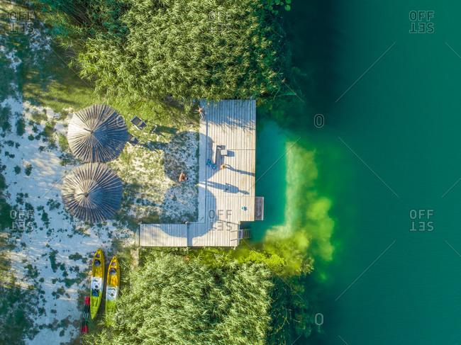 Aerial view of wooden platform pontoon on the Bacina fresh water lakes in South Dalmatia, Croatia.