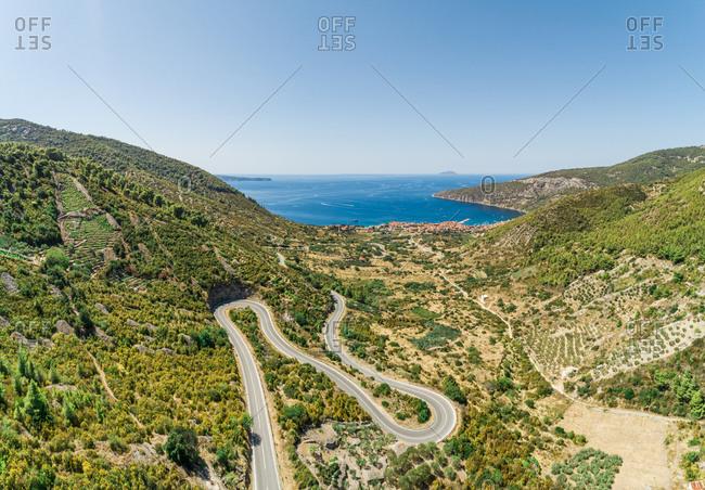 Aerial view of the winding roads to the town of  Komiza on the island of Vis, Dalmatia, Croatia.