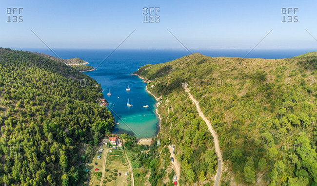 Aerial view of Stoncica bay and beach with sailing boats on the island of Vis, Dalmatia, Croatia.