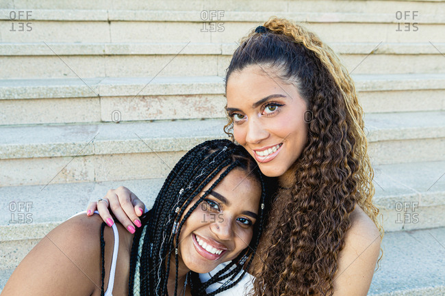 Portrait of a beautiful multiracial woman smiling and looking at camera