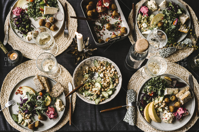 Directly above shot of food in plate by drinking glass arranged on dining table during social event