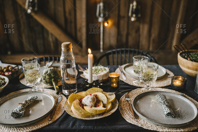 Food in plate by drinking glass arranged on dining table during social event