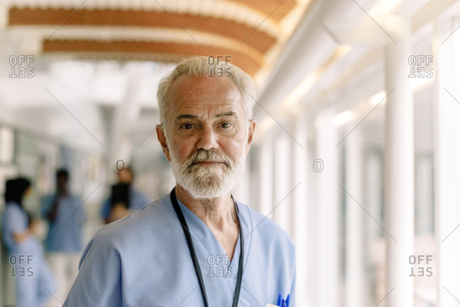 Portrait of senior male nurse in hospital corridor